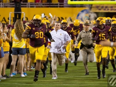 Sutton leads the Sun Devil charge onto the field.