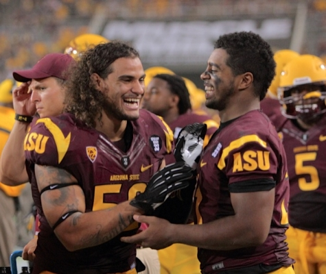 #52 Carl Bradford celebrates with #21 Chris Young following ASU's shut-out of Sacramento State